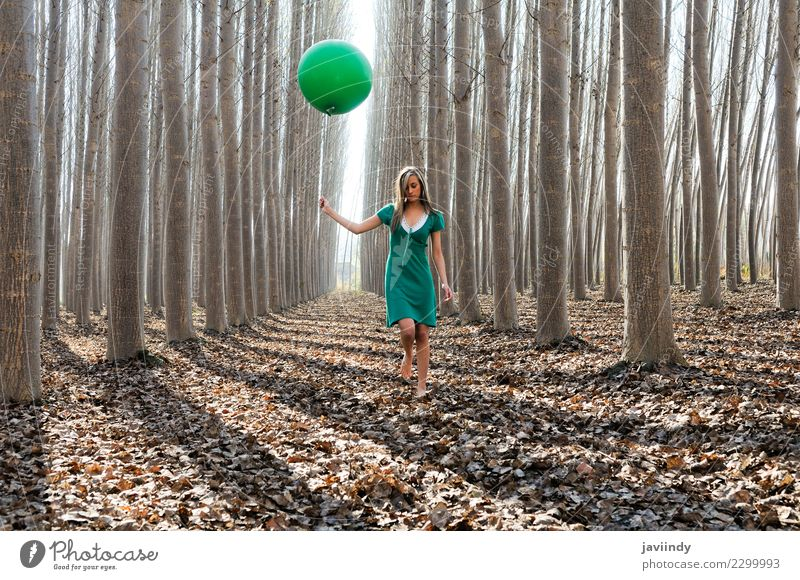 Young woman in poplar forest with green dress and balloon Woman Human being Nature Youth (Young adults) Beautiful Green Tree Relaxation Leaf Joy Forest