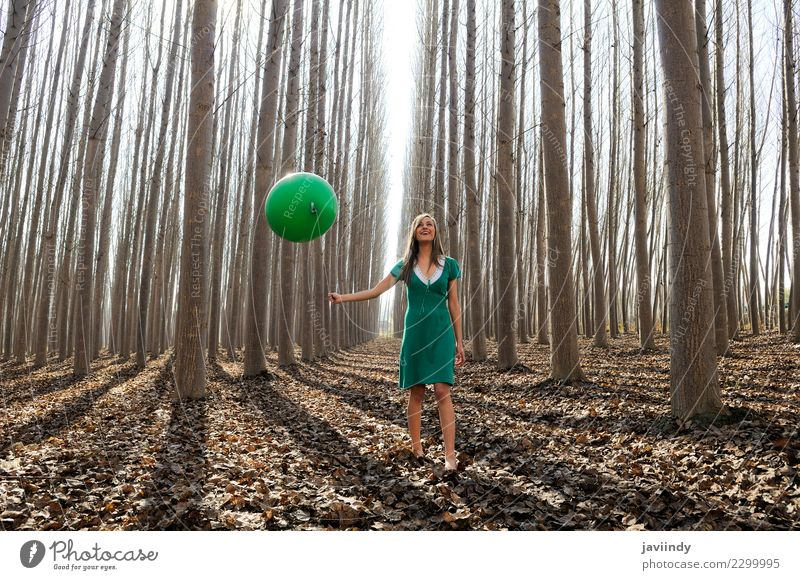 Young woman in poplar forest with green dress and balloon Woman Human being Nature Youth (Young adults) Beautiful Green Tree Leaf Joy Forest 18 - 30 years