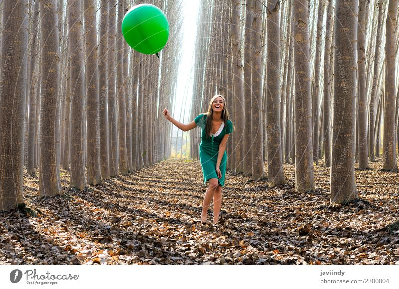 Blonde girl with green balloon and dress in the forest Lifestyle Joy Beautiful Relaxation Human being Young woman Youth (Young adults) Woman Adults 1