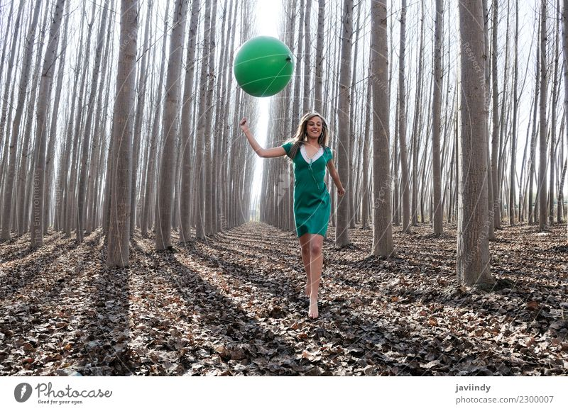 Blonde girl with green balloon and dress in the forest Woman Human being Nature Youth (Young adults) Young woman Beautiful Green Tree Relaxation Joy Forest