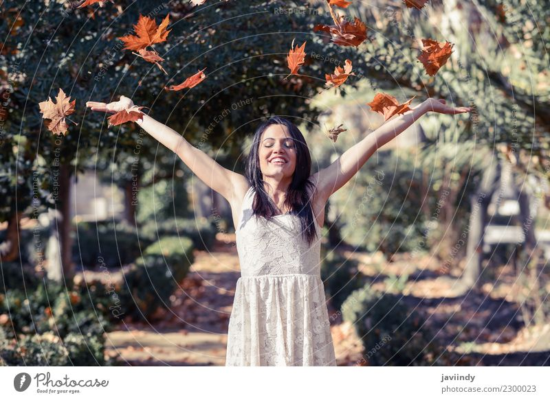 Beautiful girl with falling leaves in the autumn Woman Human being Nature Youth (Young adults) Young woman Relaxation Leaf Joy Winter 18 - 30 years Adults