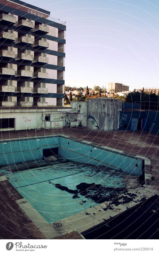 Building Dirty Facade Concrete High-rise Broken Gloomy Change Transience Swimming pool Derelict Hotel Beautiful weather Balcony Expressionless Decline