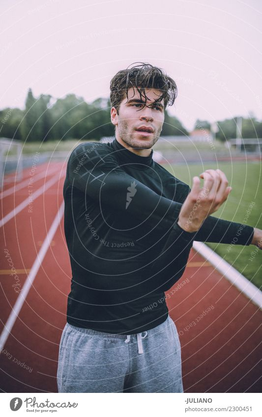 Young sports man stretching at running track Drinking water Lifestyle Joy Body Healthy Healthy Eating Health care Athletic Muscular Fitness Well-being