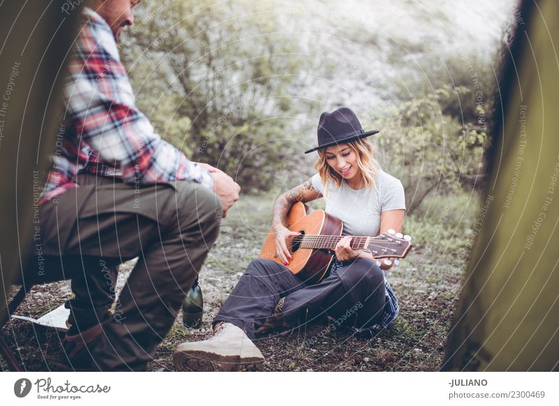 Young camping couple having a good time with guitar music Lifestyle Vacation & Travel Trip Adventure Far-off places Freedom Camping Mountain Hiking Human being