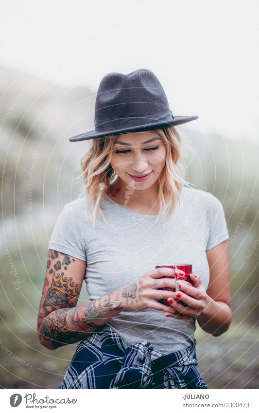 Young hiking woman is enjoying the nature with a coffee Lifestyle Vacation & Travel Trip Adventure Far-off places Freedom Camping Mountain Hiking Human being