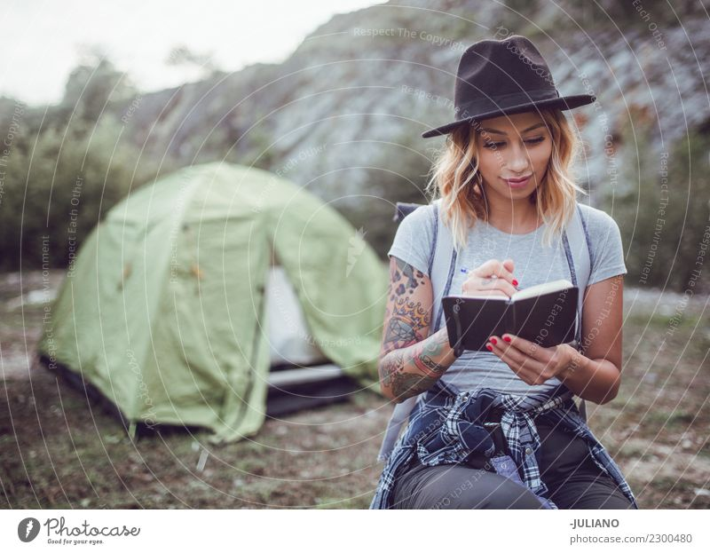 Young woman taking notes in the nature Human being Nature Vacation & Travel Youth (Young adults) Beautiful Joy Far-off places Mountain 18 - 30 years Lifestyle