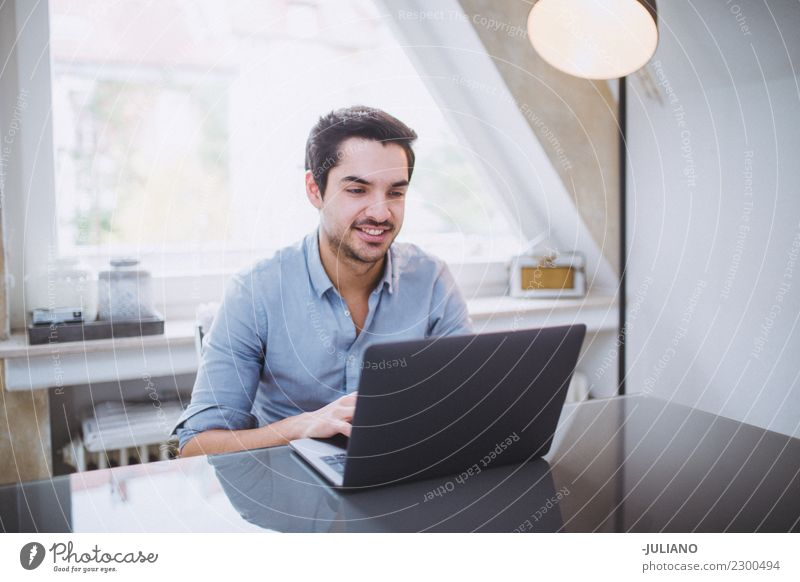 Man is getting work done on notebook at home office Communicate Financial Industry Businessman Observe Work and employment Notebook Professional Success Office