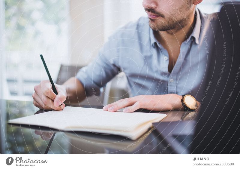 Young businessman is writing down notesk Communicate Financial Industry Businessman Observe Work and employment Notebook Professional Success Office Shopping