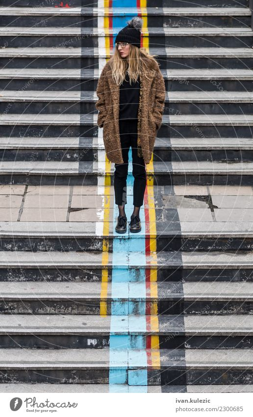 Trendy girl standing on the stairs Woman Human being Youth (Young adults) Town Beautiful Relaxation Loneliness Winter 18 - 30 years Black Face Adults Street