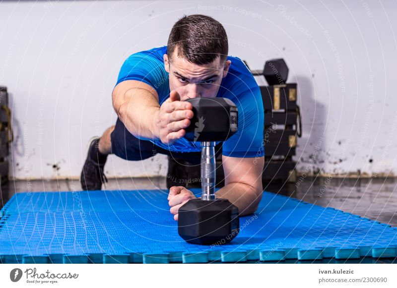 Fit, muscular young man doing plank at the gym Lifestyle Body Wellness Sports Fitness Sports Training Sportsperson Work and employment Human being Man Adults