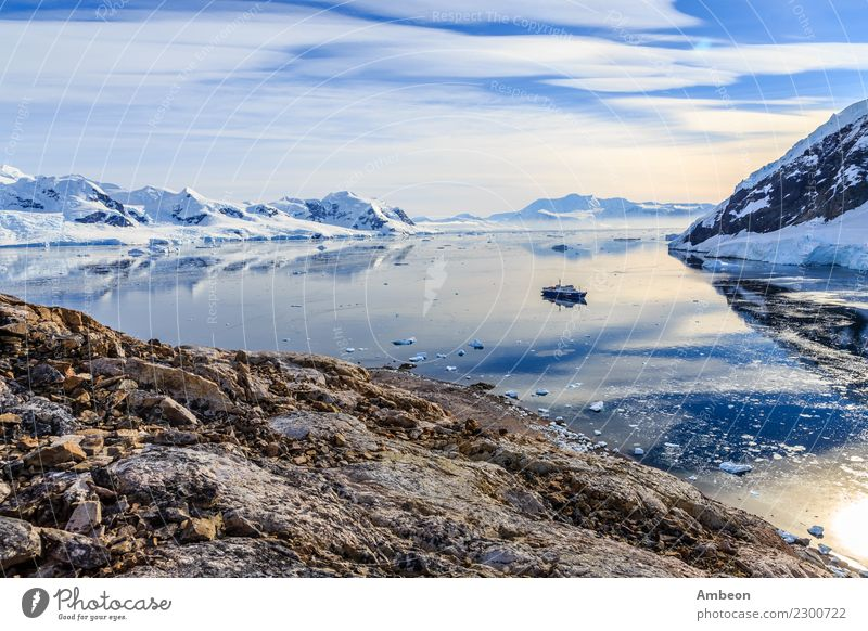 View from the rocky coast to the Neco bay surrounded by glaciers Sky Nature Vacation & Travel Beautiful Water Landscape Sun Ocean Clouds Winter Far-off places