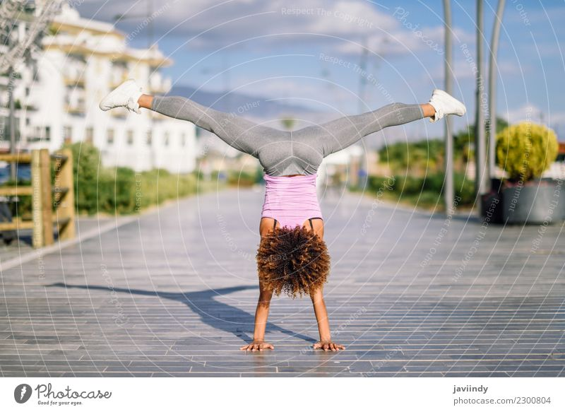 Black fit woman doing fitness acrobatics Woman Human being Youth (Young adults) Young woman Beautiful 18 - 30 years Adults Street Lifestyle Sports