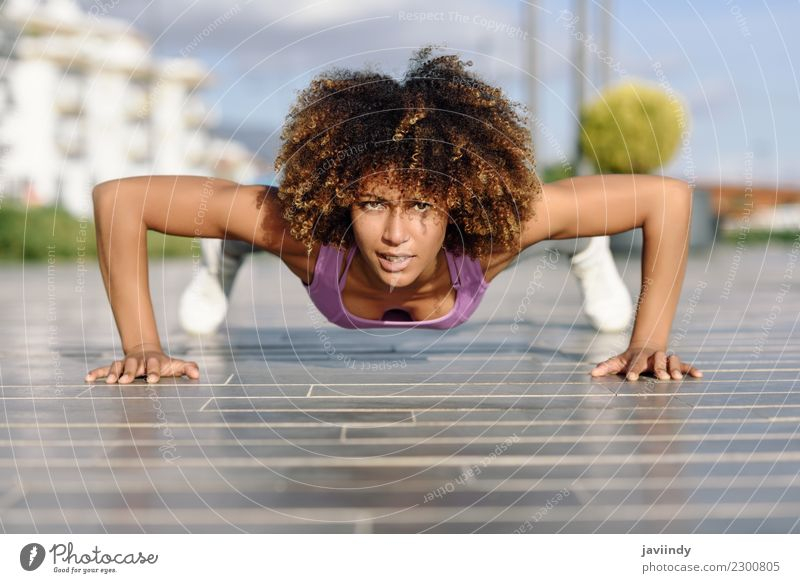 Black fit woman doing pushups on urban floor. Lifestyle Body Hair and hairstyles Leisure and hobbies Sports Human being Young woman Youth (Young adults) Woman