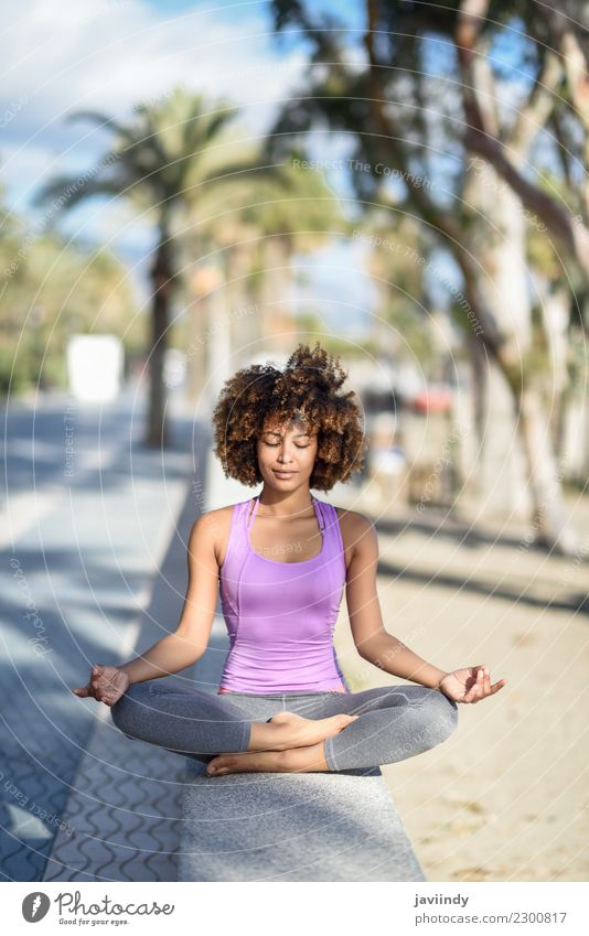 Black woman,doing yoga asana with eyes closed. Lifestyle Beautiful Body Hair and hairstyles Wellness Relaxation Meditation Leisure and hobbies Beach Ocean