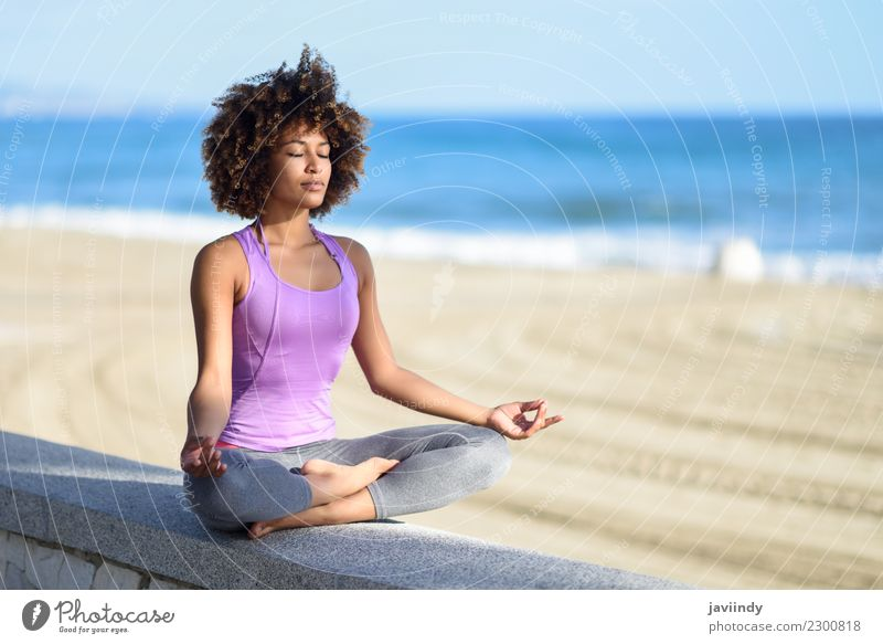 Black woman, afro hair doing yoga in the beach. Eyes closed Lifestyle Hair and hairstyles Wellness Relaxation Meditation Leisure and hobbies Beach Sports Yoga