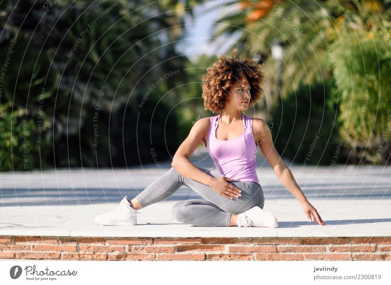 Black woman, afro hairstyle, doing yoga on promenade. Lifestyle Beautiful Body Hair and hairstyles Wellness Relaxation Meditation Leisure and hobbies Beach