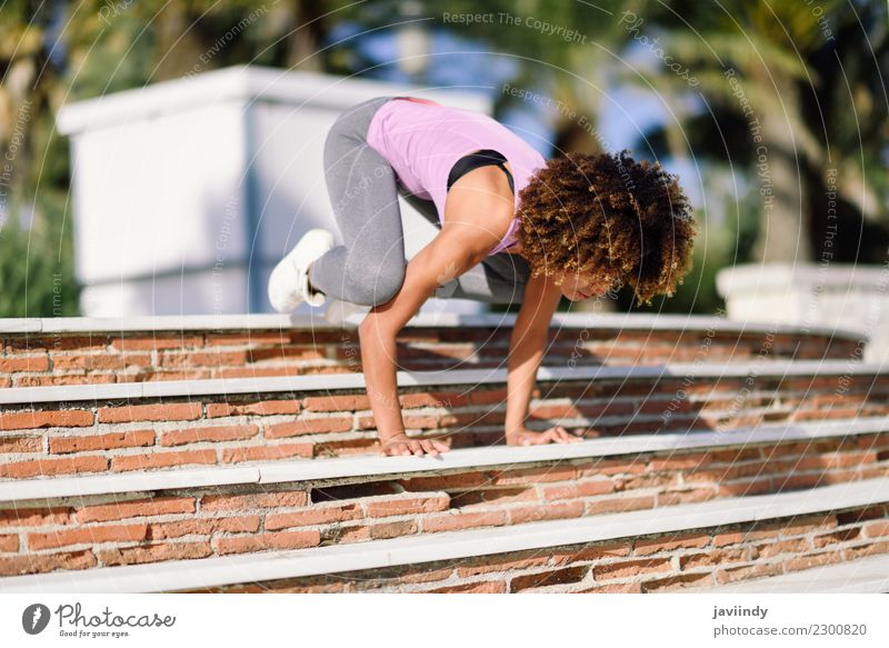 Black fit woman doing fitness acrobatics in the street Lifestyle Beautiful Body Hair and hairstyles Leisure and hobbies Sports Yoga Human being Young woman