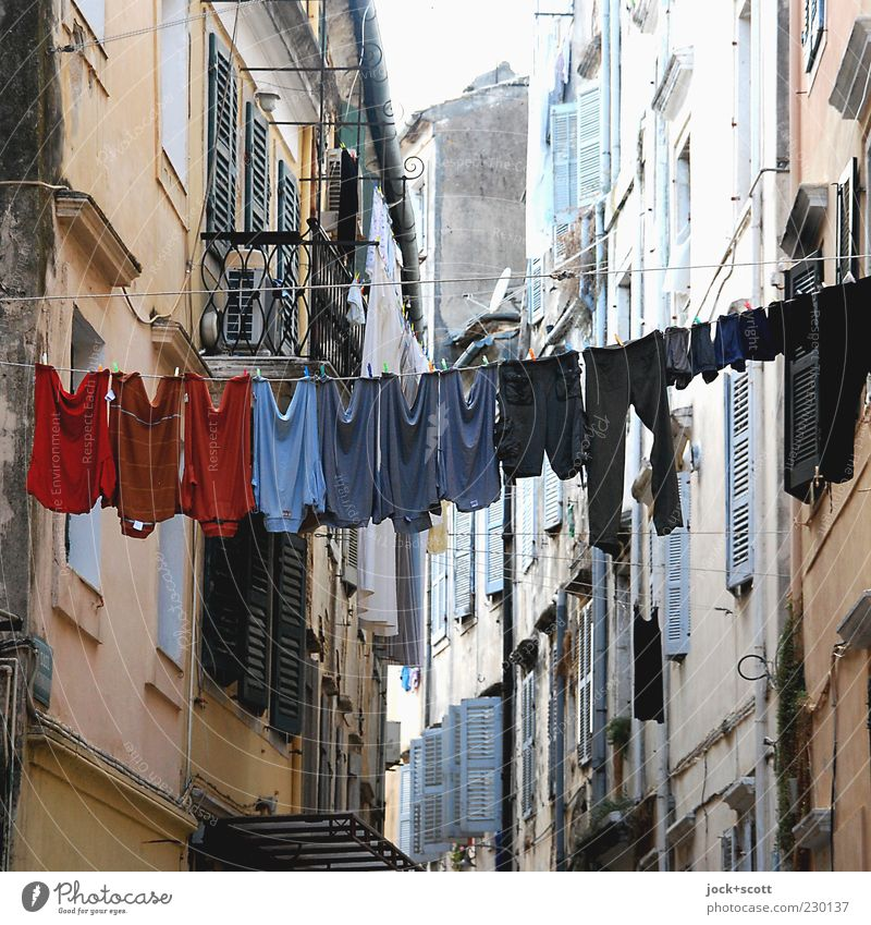 Washing day sorted on the line Style City trip Living or residing Warmth Corfu Old town Town house (City: Block of flats) Facade shutters T-shirt Pants Stone
