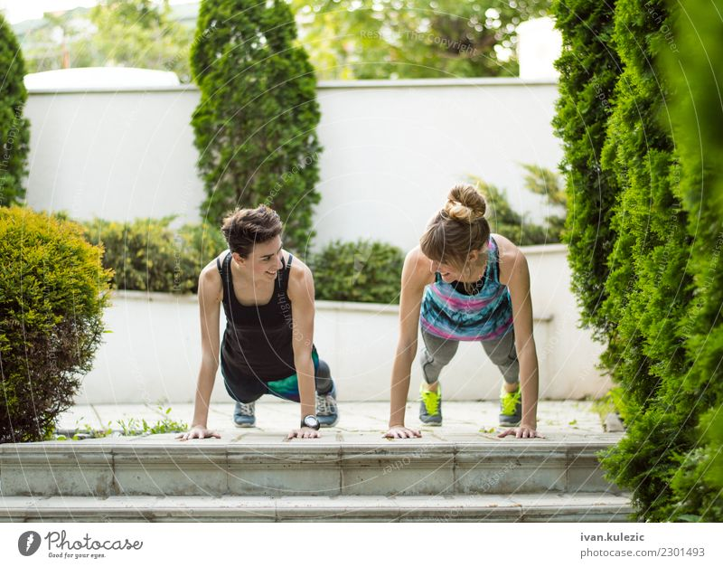 Couple of girls doing push ups Lifestyle Beautiful Body Sports Yoga Human being Woman Adults Fitness Smiling Athletic Friendliness Happiness Energy Teamwork
