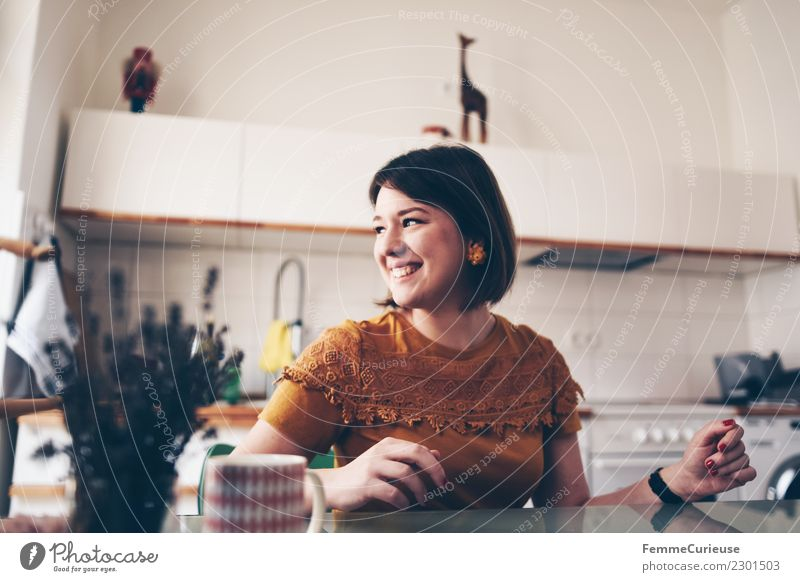 Young brunette woman sitting in a kitchen Lifestyle Elegant Style Feminine Young woman Youth (Young adults) Woman Adults 1 Human being 18 - 30 years already