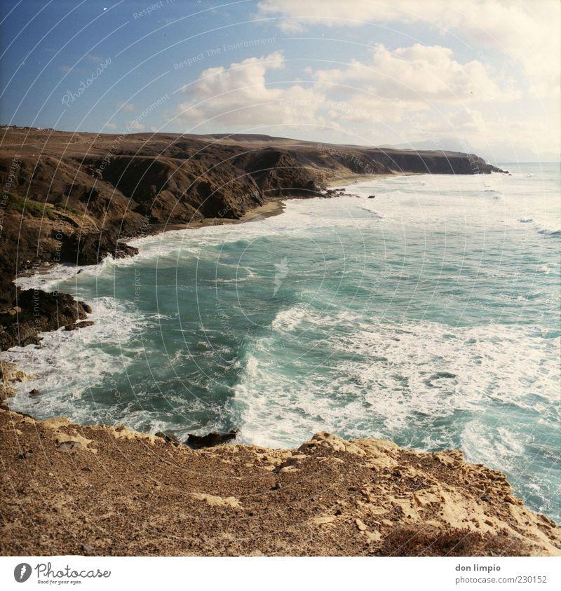 la pared Landscape Sun Summer Beautiful weather Warmth Drought Hill Rock Waves Coast Ocean Atlantic Ocean Island Fuerteventura Far-off places Infinity Moody