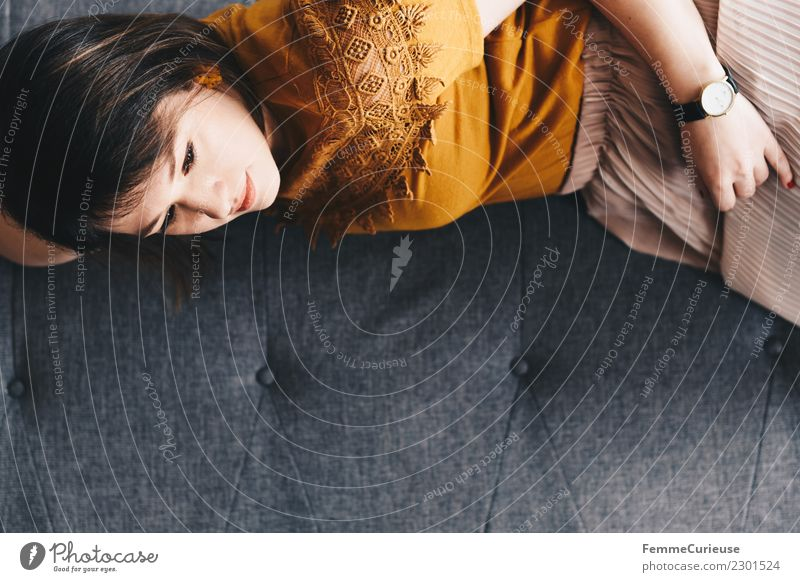 Young woman lying on the couch Feminine Youth (Young adults) Woman Adults 1 Human being 18 - 30 years Relaxation Serene Calm Living or residing Break Siesta