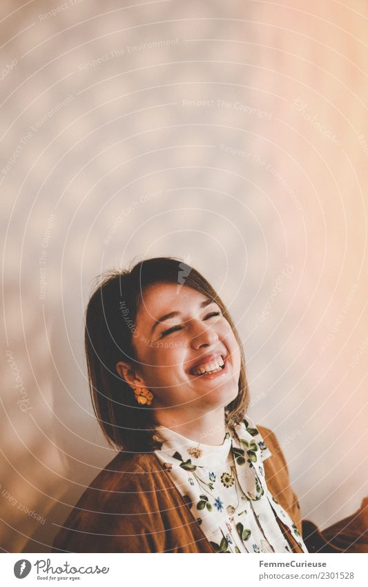 Young laughing woman in a room with play of light Lifestyle Elegant Style Feminine Young woman Youth (Young adults) Woman Adults 1 Human being 18 - 30 years