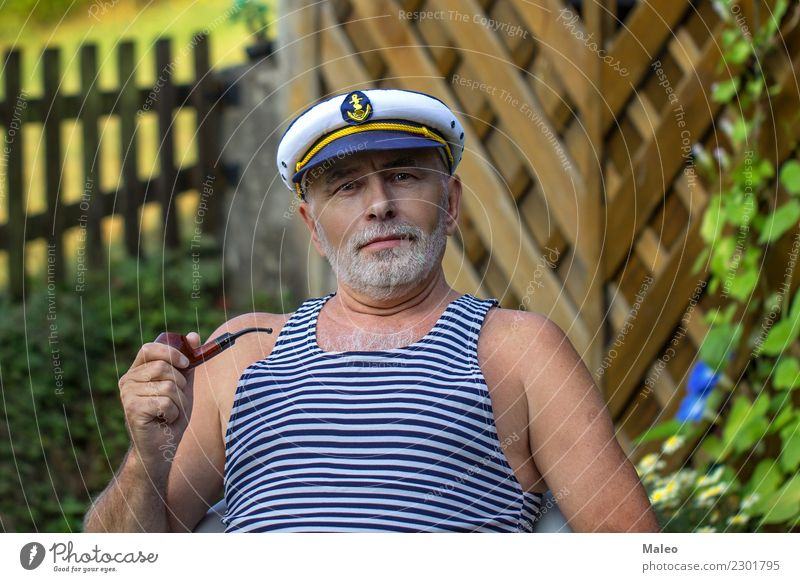 Captain with a whistle Pipe Seaman Experience Attractive Hat Gale White Adults Watercraft Fashion portrait Smiling Facial hair Face Man Human being