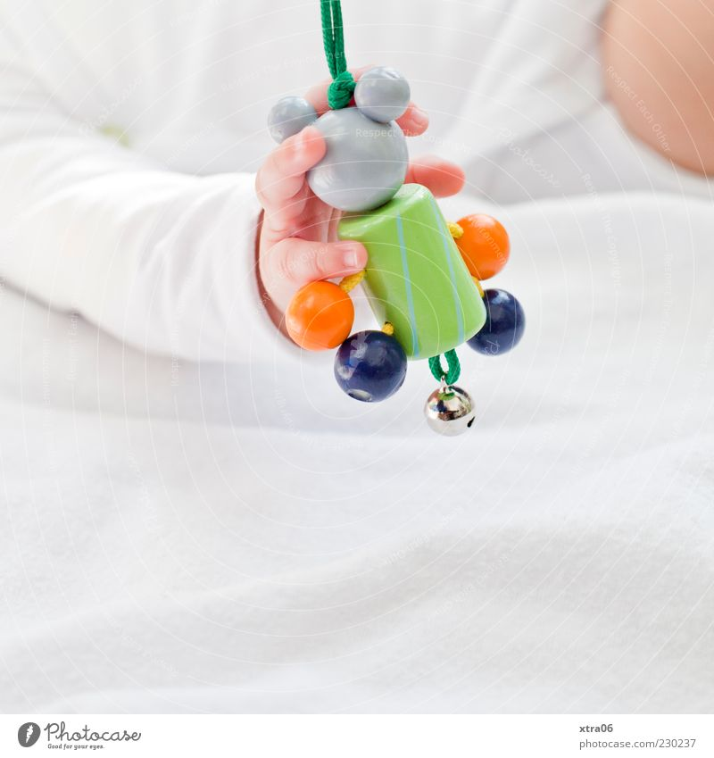Human being Hand Girl Wood Small Baby Arm Fingers Cute Child To hold on Delicate Grasp Bell Dexterity 0 - 12 months