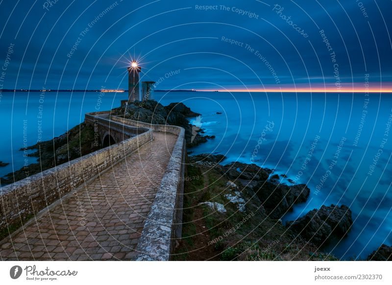 Stone path over bridge to lighthouse, washed by the sea at blue hour Lighthouse coast seascape Ocean Sky Waves France Brittany Phare du Petit Minou Horizon