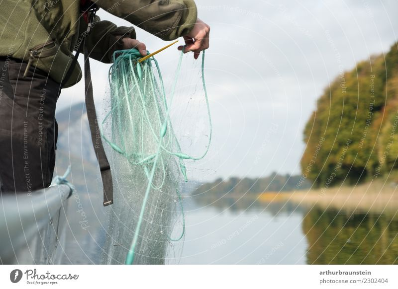 Fisherman on fishing boat on lake lays out fishing net Food Nutrition Healthy Eating Leisure and hobbies Fishing (Angle) Work and employment Profession Fishery