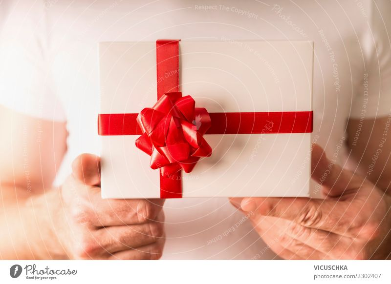 Male hands holding gift with red bow Style Design Life Party Event Feasts & Celebrations Valentine's Day Christmas & Advent Human being Masculine Hand