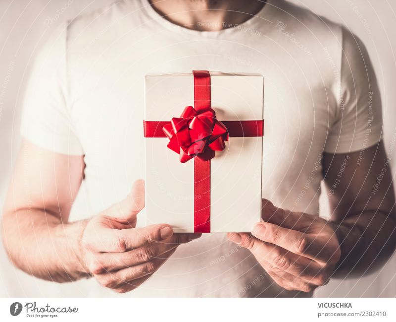 Gift box with red ribbon in the hands Style Design Joy Beautiful Event Valentine's Day Christmas & Advent Human being Masculine Hand Decoration Moody Love Man