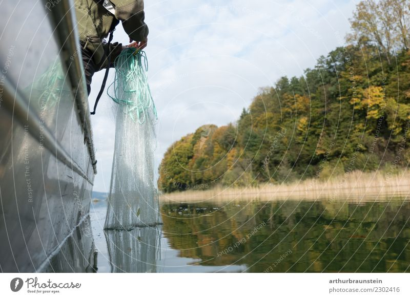 Fischer throws out fishing net Human being Nature Youth (Young adults) Water Forest Environment Food Lake Work and employment Watercraft Trip