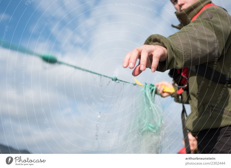 Young fisherman catches up with fishing net Food Fish Nutrition Leisure and hobbies Fishing (Angle) Trip Professional training Fisherman Economy Fishery