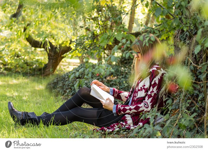 Girl siting under the tree, reading the book Lifestyle Happy Beautiful Relaxation Leisure and hobbies Reading Freedom Sun Study Academic studies Woman Adults