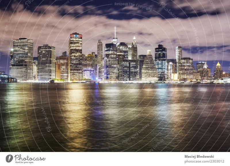 New York City skyline at night, USA. Vacation & Travel Town Architecture Building Modern High-rise Elegant Success Shopping Idea Money River Skyline