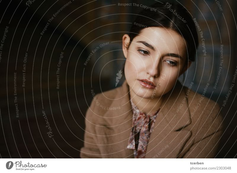 Close-up portrait of a melancholic young woman with brown coat Human being Youth (Young adults) Old Young woman Beautiful Colour Loneliness 18 - 30 years Face