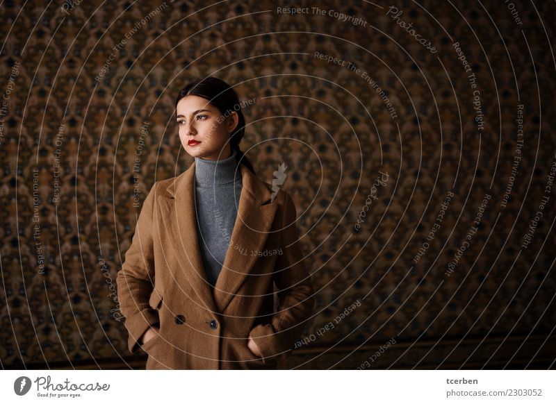 Portrait of a young girl with coat in urban tile background Woman Human being Youth (Young adults) Old Beautiful Loneliness Calm Winter 18 - 30 years Adults