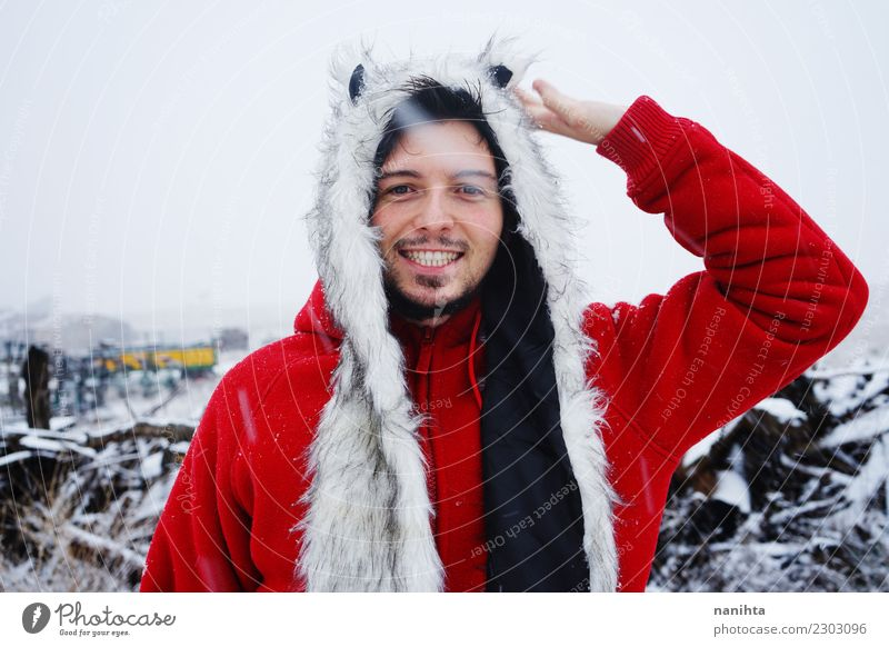 Happy man in a snowy day Human being Vacation & Travel Man Red Joy Winter Adults Life Lifestyle Environment Snow Style Snowfall Masculine Weather Smiling