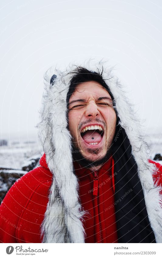 Young man screaming in a winter day Human being Vacation & Travel Youth (Young adults) Man Young woman Red Winter Adults Lifestyle Funny Snow Style Freedom Wild