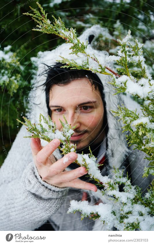 Young man enjoying the snow Human being Nature Youth (Young adults) Man Green Tree Joy Winter Forest Adults Lifestyle Environment Cold Snow Style Snowfall