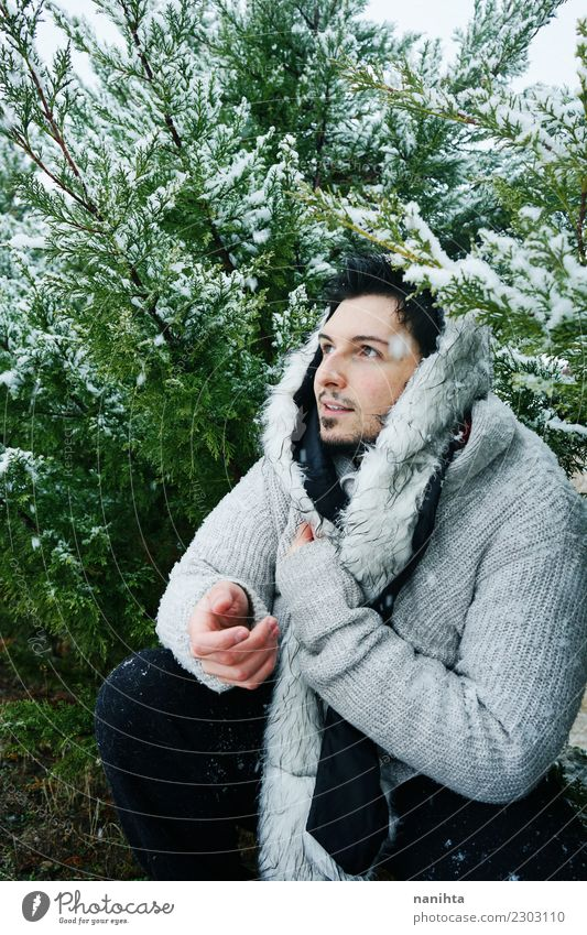 Young man enjoying a winter day Human being Nature Youth (Young adults) Man Beautiful Green Winter Adults Lifestyle Environment Cold Snow Style Snowfall
