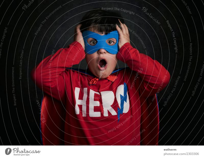 surprised child playing superhero Lifestyle Joy Party Event Feasts & Celebrations Carnival New Year's Eve Human being Masculine Child Infancy 1 3 - 8 years Mask