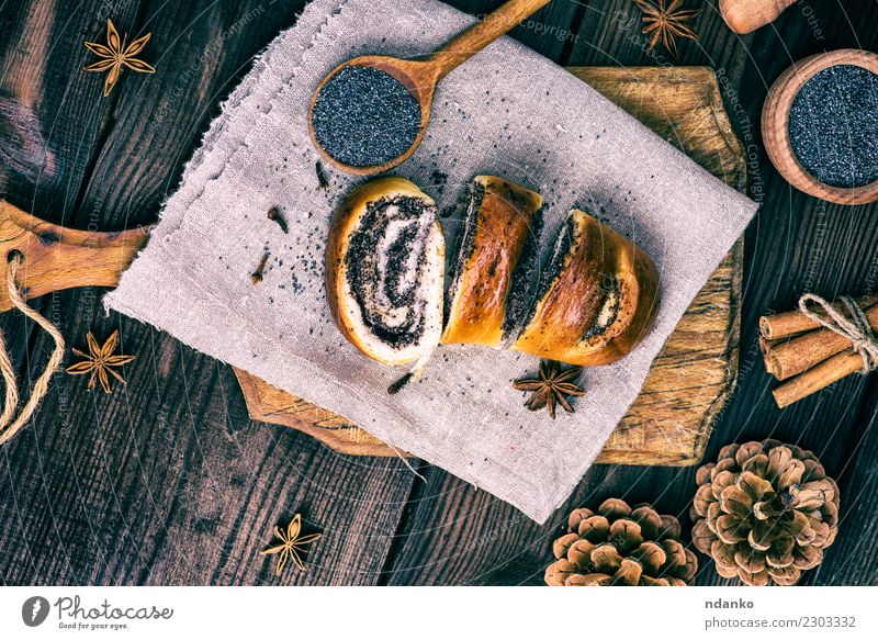homemade roll with poppy seeds Bread Dessert Spoon Table Wood Eating Fresh Delicious Above Brown Tradition biscuit Chopping board Home-made Cut christmas Rustic