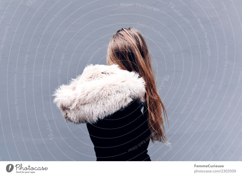 Back view of young blonde long haired woman in coat with fur Lifestyle Elegant Style Feminine Young woman Youth (Young adults) Woman Adults 1 Human being