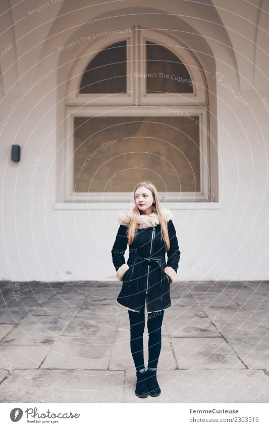 Young woman in winter coat Elegant Style Feminine Youth (Young adults) Woman Adults 1 Human being 18 - 30 years Beautiful Thin Coat Winter coat Jeans Blonde