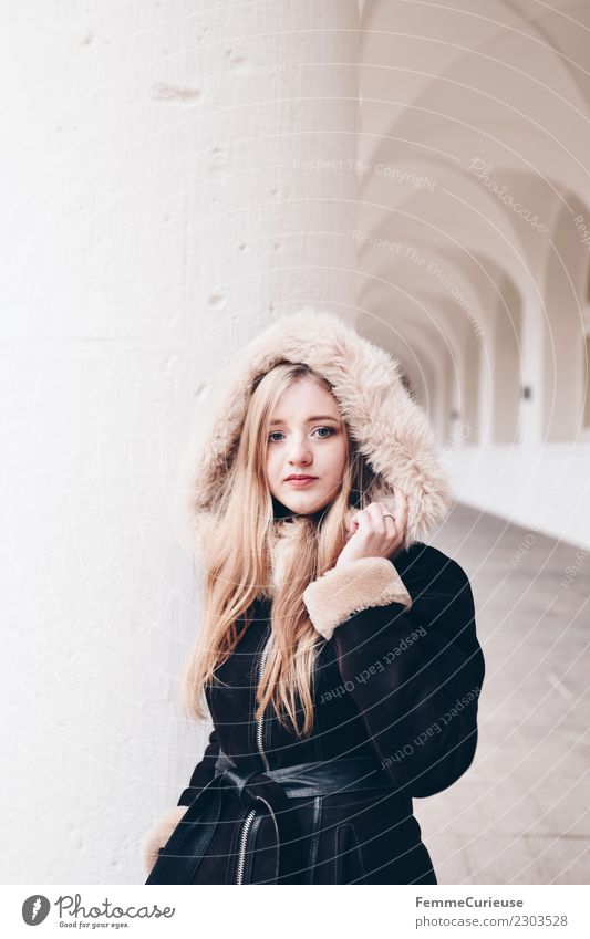 Young woman wearing a coat with fur collar Lifestyle Elegant Style Feminine Youth (Young adults) Woman Adults 1 Human being 18 - 30 years Fashion Beautiful