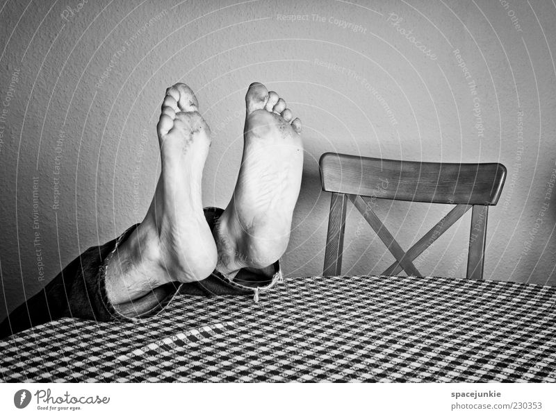 feet Masculine Man Adults Feet 1 Human being Lie Under Crazy Table Chair Dirty Whimsical Funny Black & white photo Interior shot Copy Space bottom