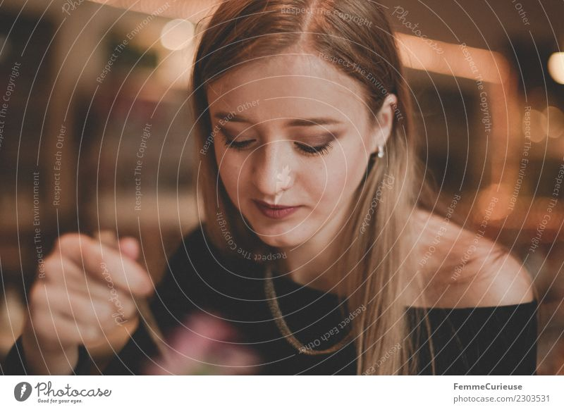 Young woman in café Elegant Feminine Youth (Young adults) Woman Adults 1 Human being 18 - 30 years Drinking Café Blonde Hand Spoon Warm colour Smooth hair